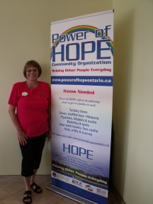 Penny Jamieson proudly shows off her new Power of HOPE sign