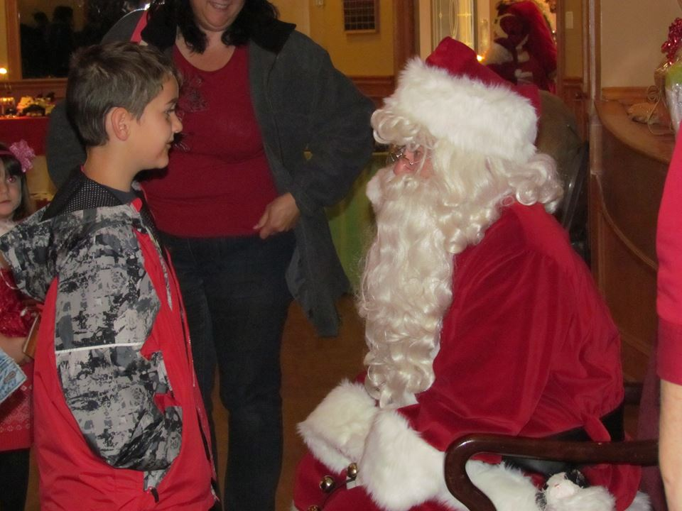 A visitor to the show tells Santa what he wants for Christmas.